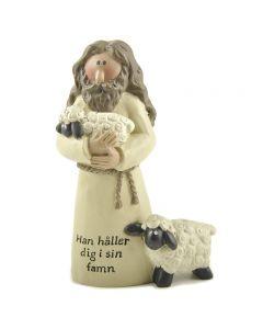 Jesus med två lamm. Han håller dig i sin famn
